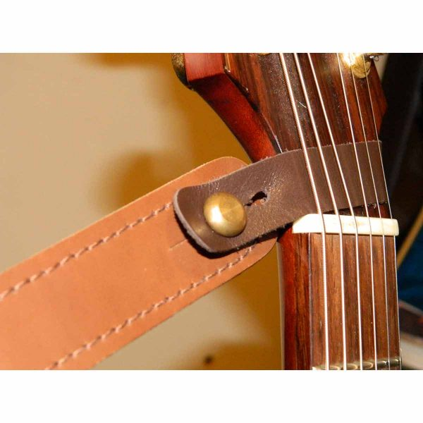 Strapmate secures your guitar strap to your acoustic guitar