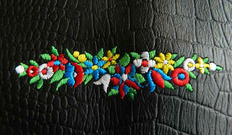 Bespoke embroidery for leather guitar straps
